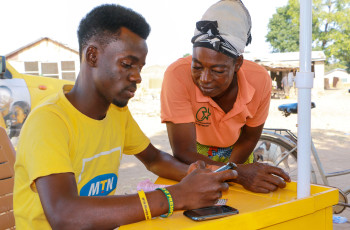 MTN officials have been helping farmers enrol in mobile banking © ACDI/VOCA