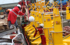 The FADs consist of a large buoy attached to a floating 'mat' a few meters across. © FAO