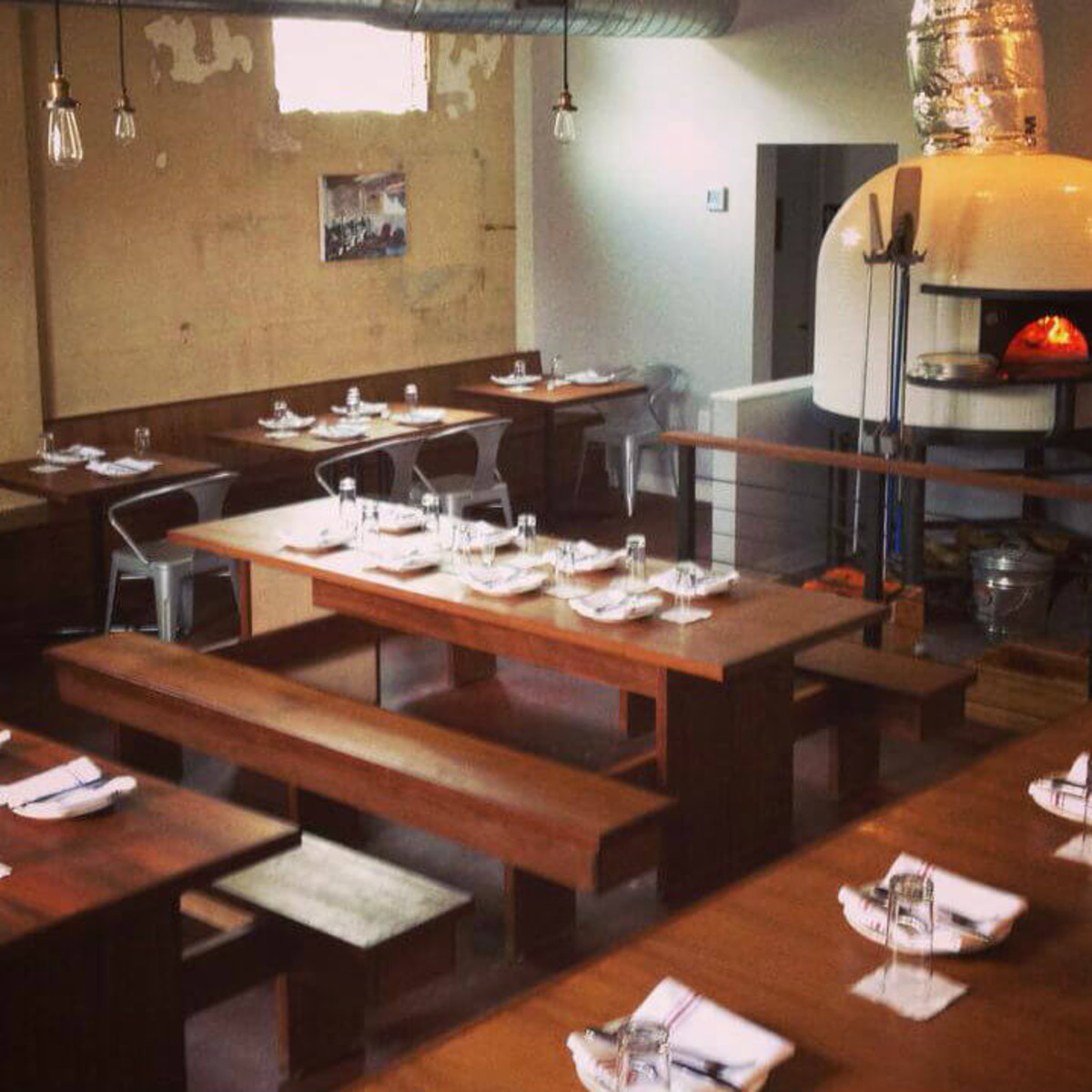 Bufalina pizza restaurant interior with brick oven
