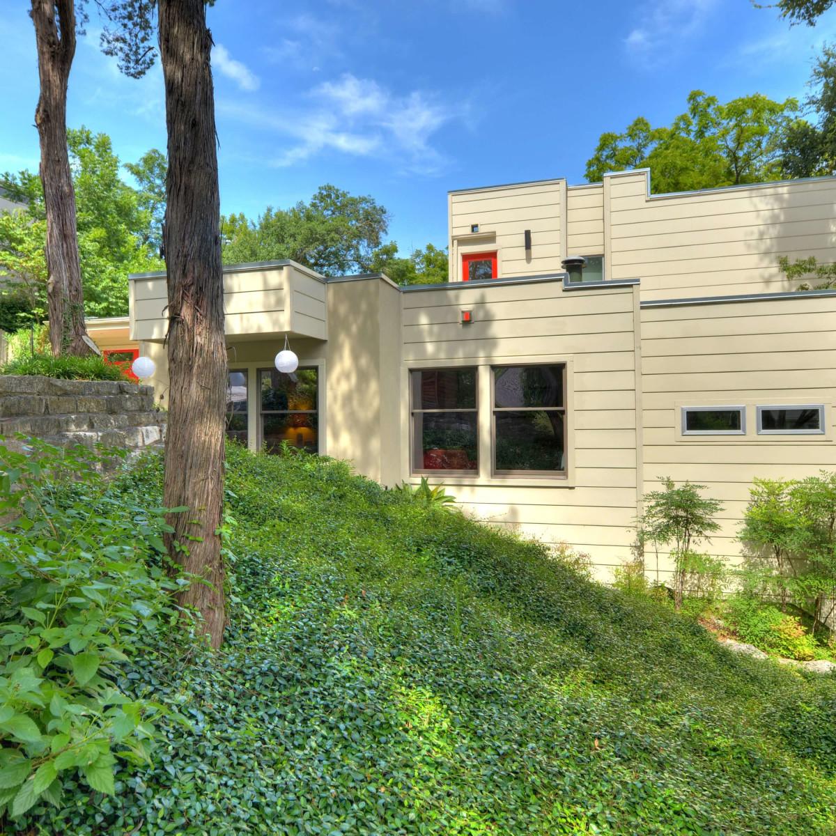 Austin home house 5932 Highland Hills Dr 78731 exterior side hill