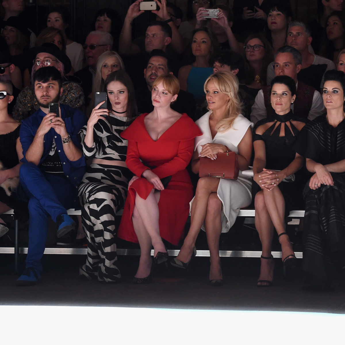 Christian Siriano front row, Kelly Osbourne with dog