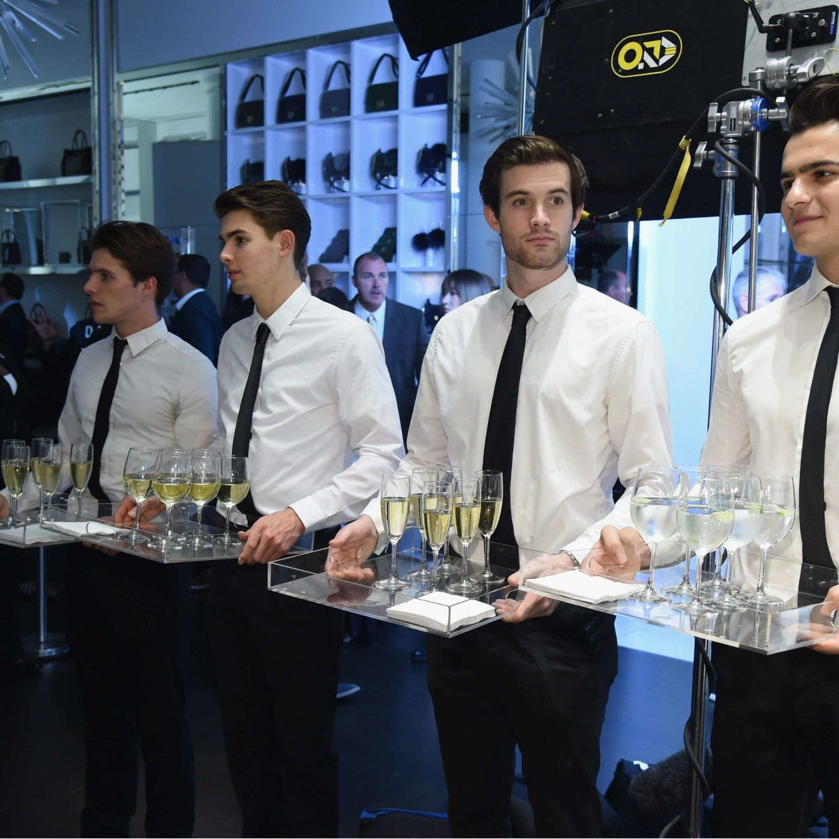 Waiters with champagne at Michael Kors watch launch