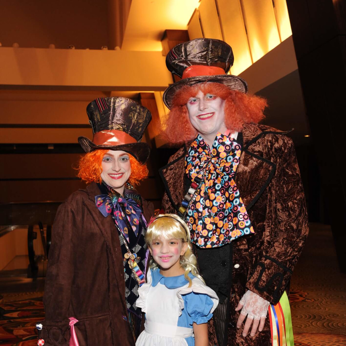 Joelle and Mitch Derrick, gala honorees, with their daughter at Boo Ball