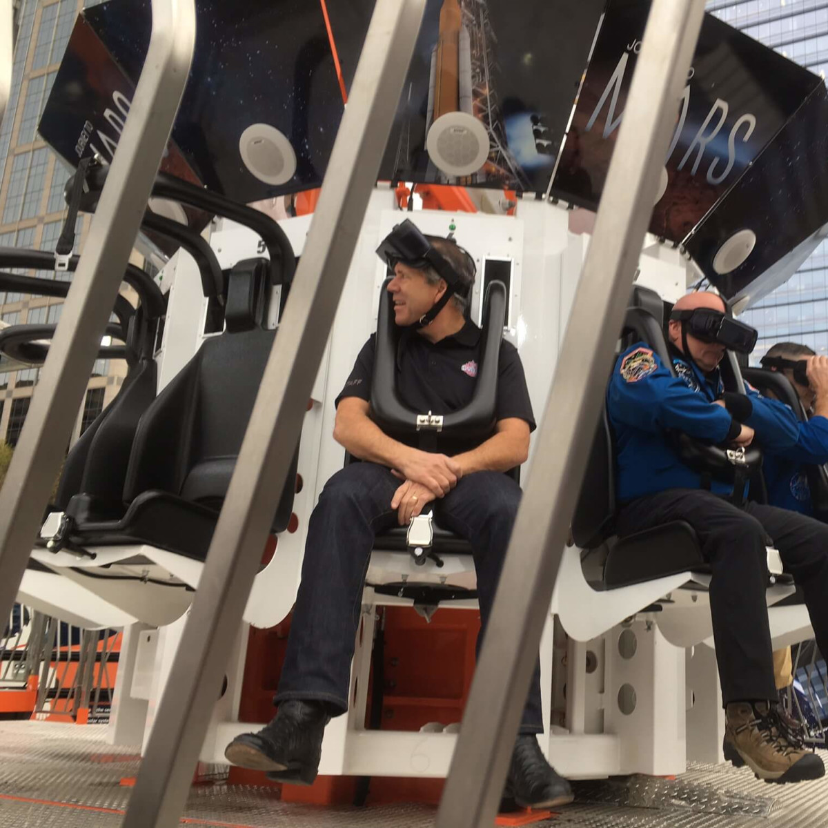 Ric Campo and Scott Kelly wait to being the Future Flight ride at Discovery Green