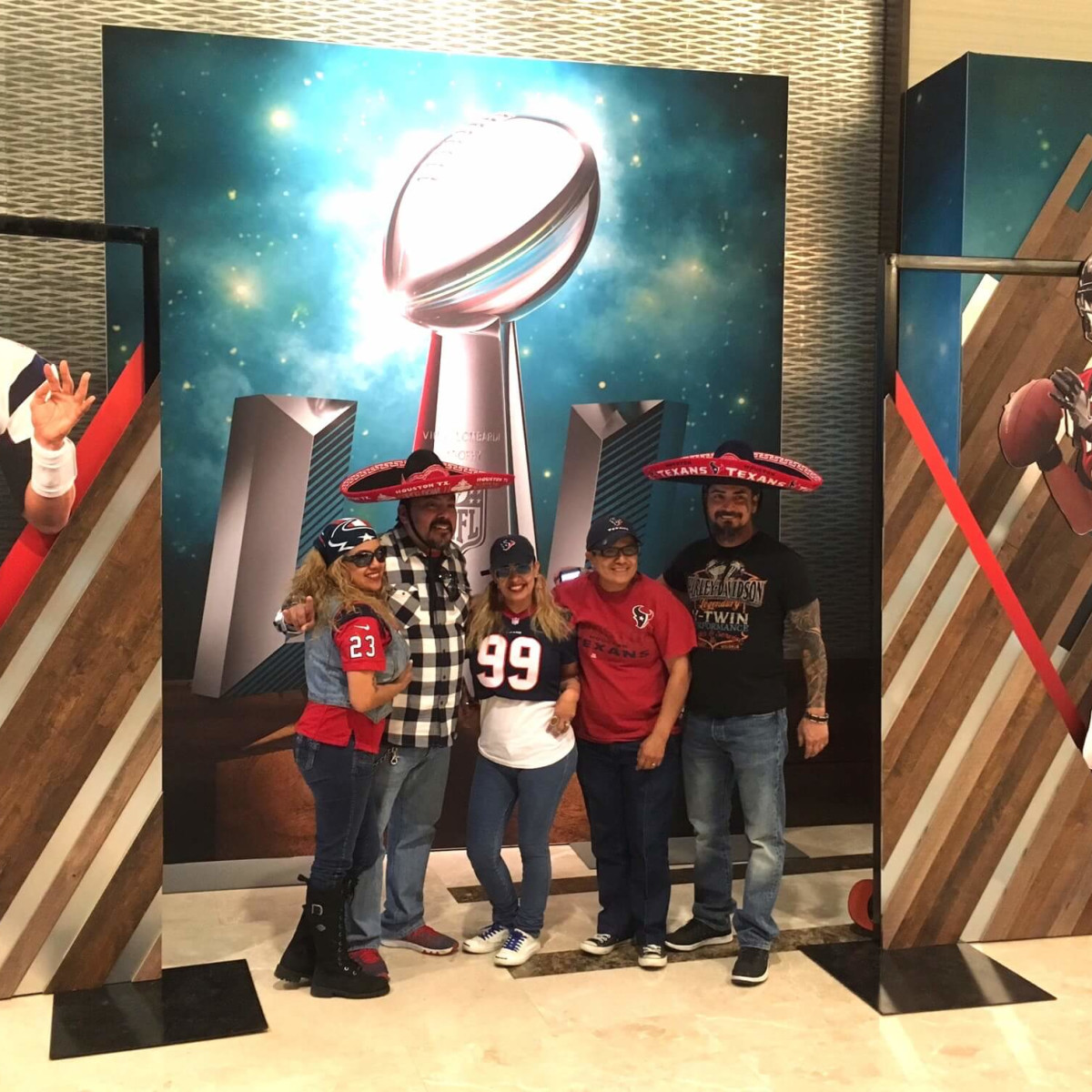 Super Bowl fans posing at Marriott Marquis hotel