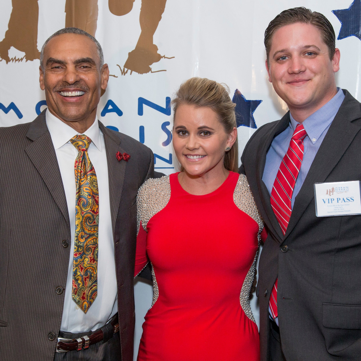 Herm Edwards, Jayme Lamm, Travis Frey at Moran Norris gala