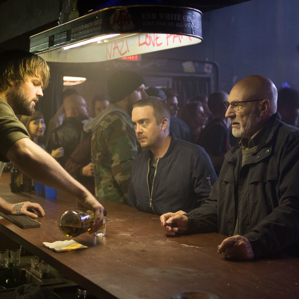 Jake Kasch, Macon Blair, and Patrick Stewart in Green Room
