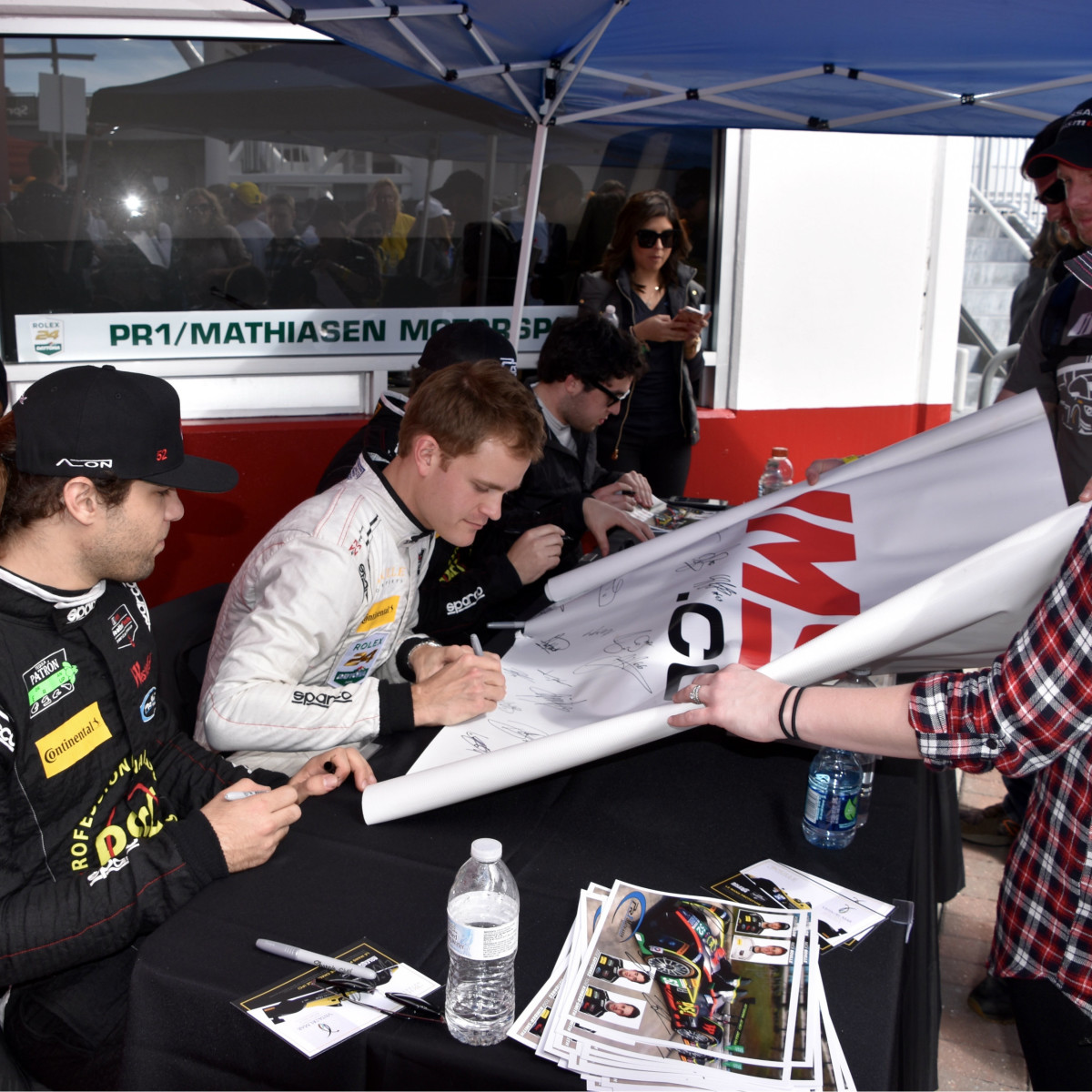Nick Boulle signing autographs at Rolex 24 at Daytona
