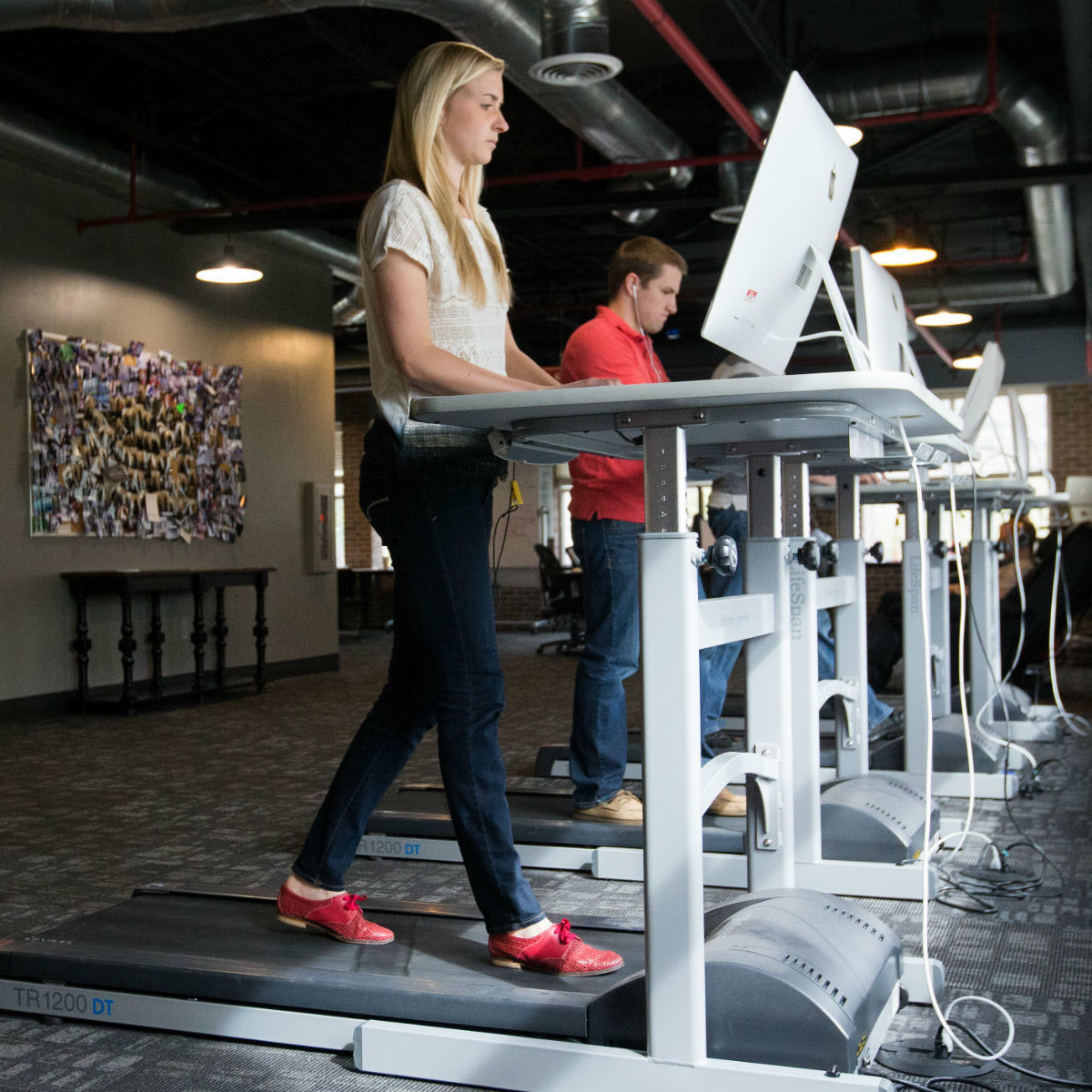 Girl at a treadmill desk
