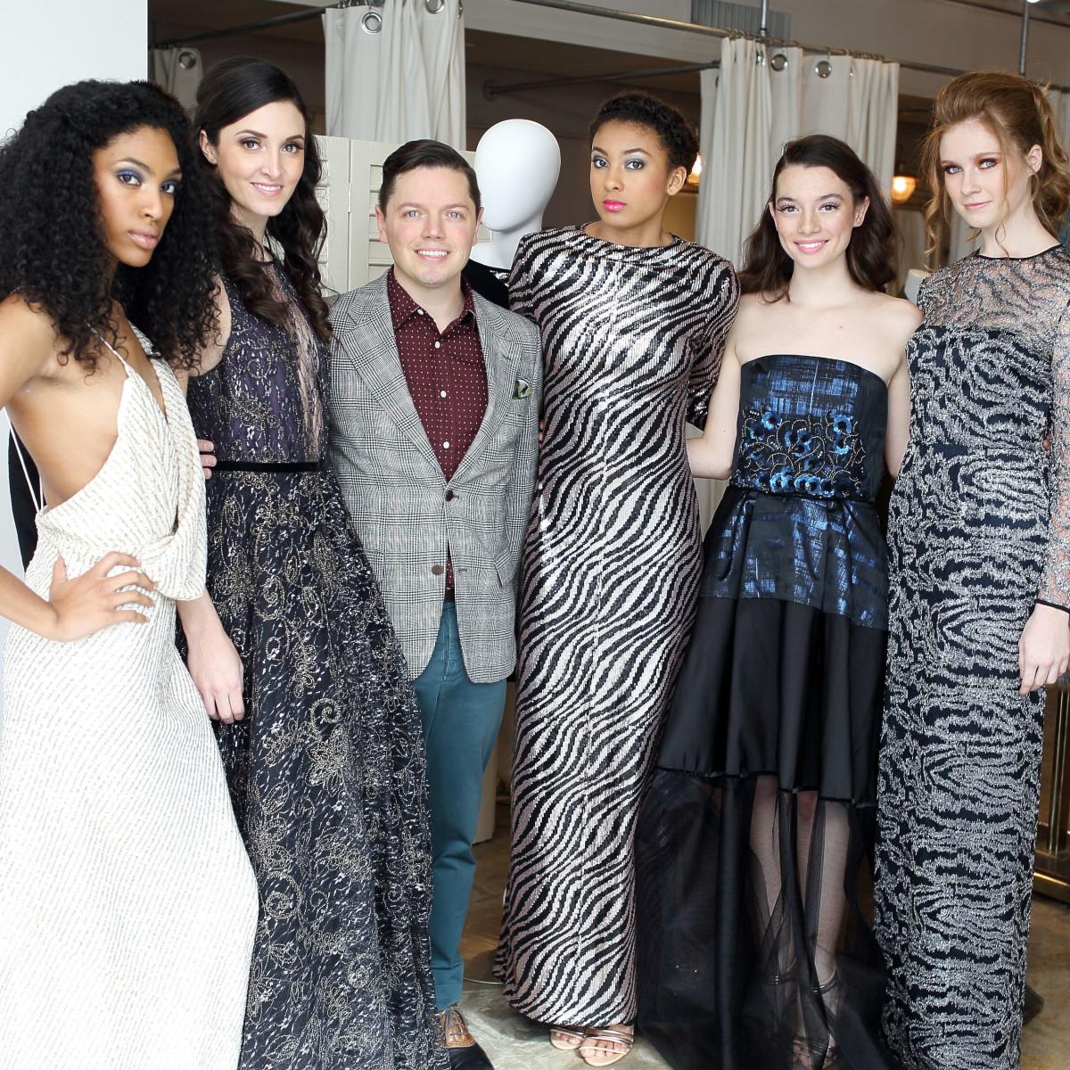 David Peck with models at Miles David fashion show