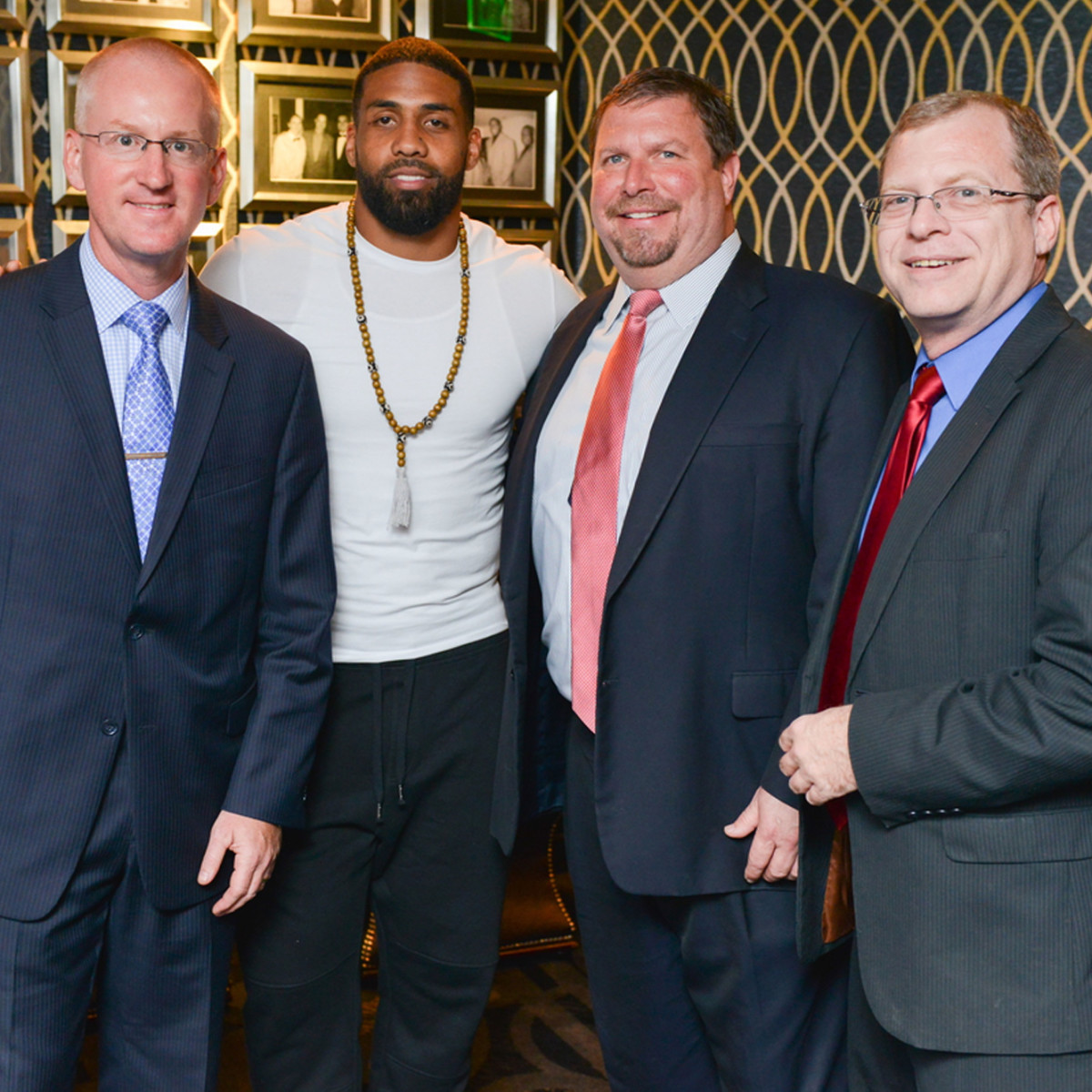 Arian Foster charity dinner Morton's Morton's The Steakhouse Executives Scott Crain, Tom Kohler, GM Eric Kresse with Arian Foster