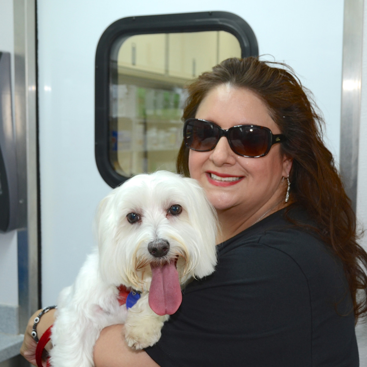 Emancipet Houston grand opening Sonia Soto with Jesse