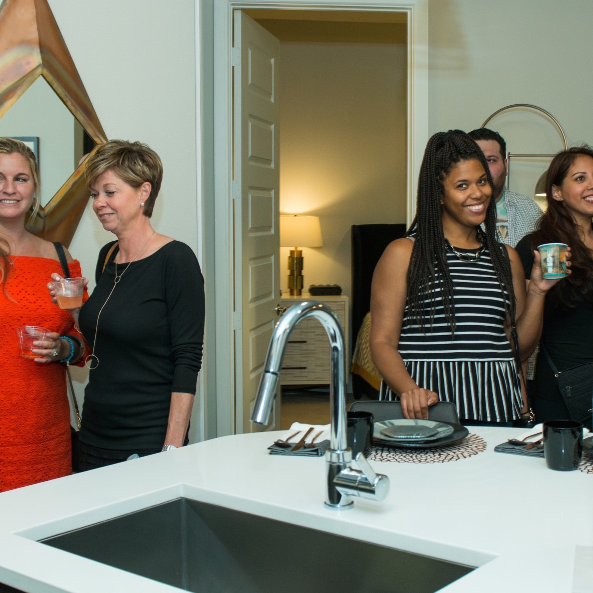 Guests tour Marq 31 apartment at CultureMap Summer Social
