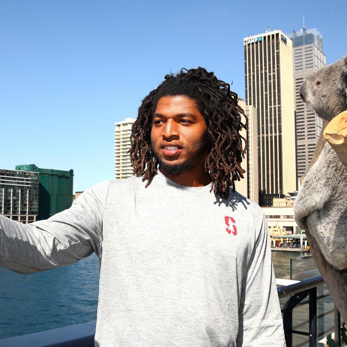 Stanford player Peter Kalambayi and koala in Sydney Australia