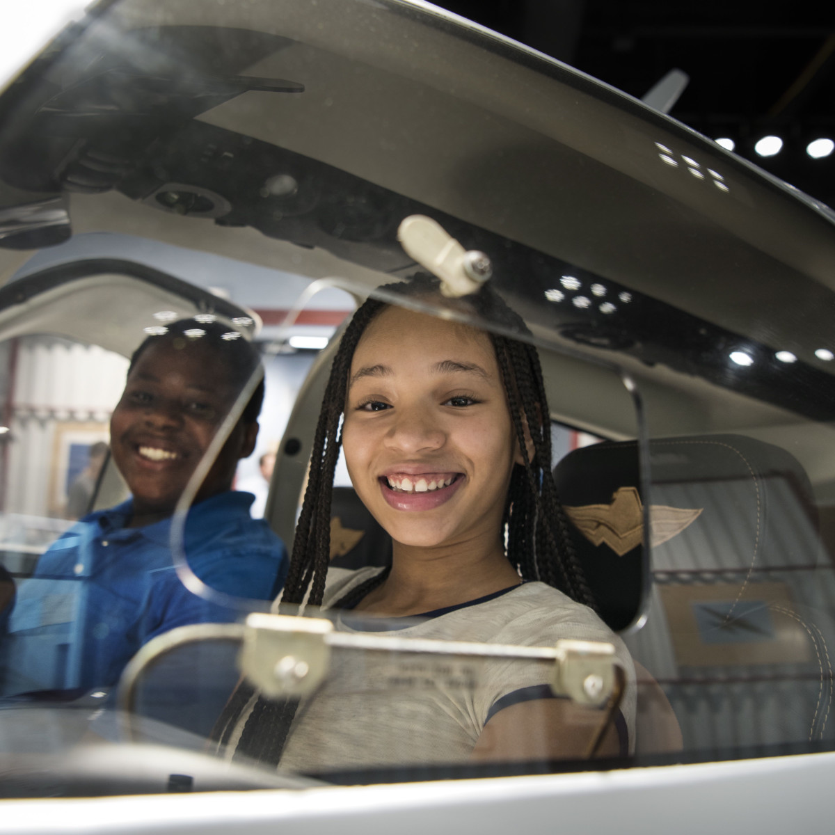 Lone Star Flight Museum visitors in cockpit of airplane