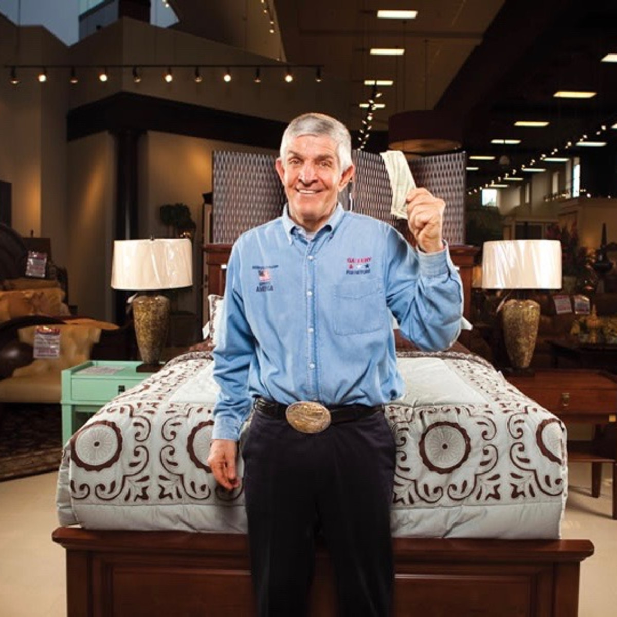 Mattress Mac or Jim McIngvale of Gallery Furniture holding up dollar bills