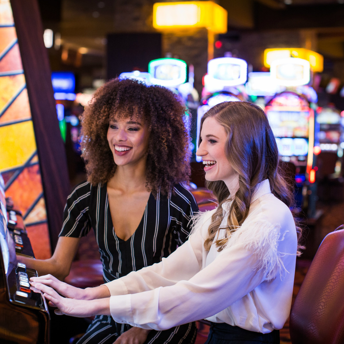 Women playing slot machines
