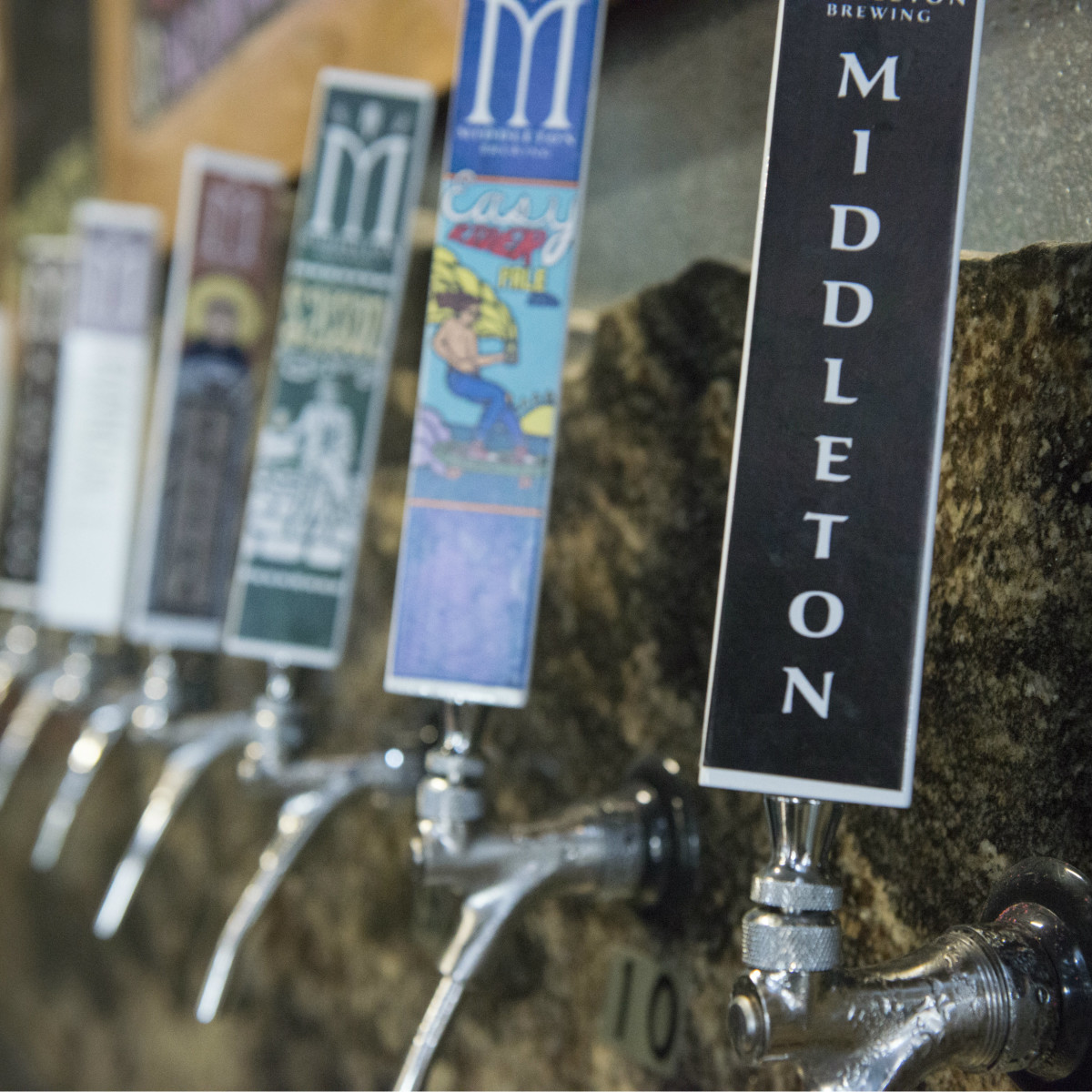 Beer taps at Middleton Brewing in San Marcos