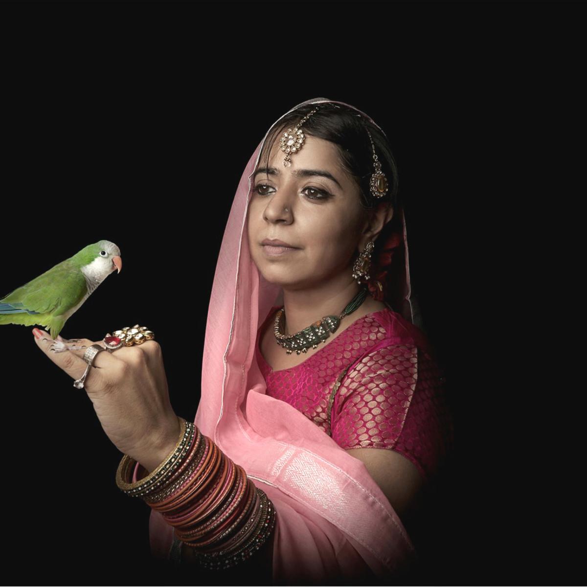 Fotofest women in sari with parrot