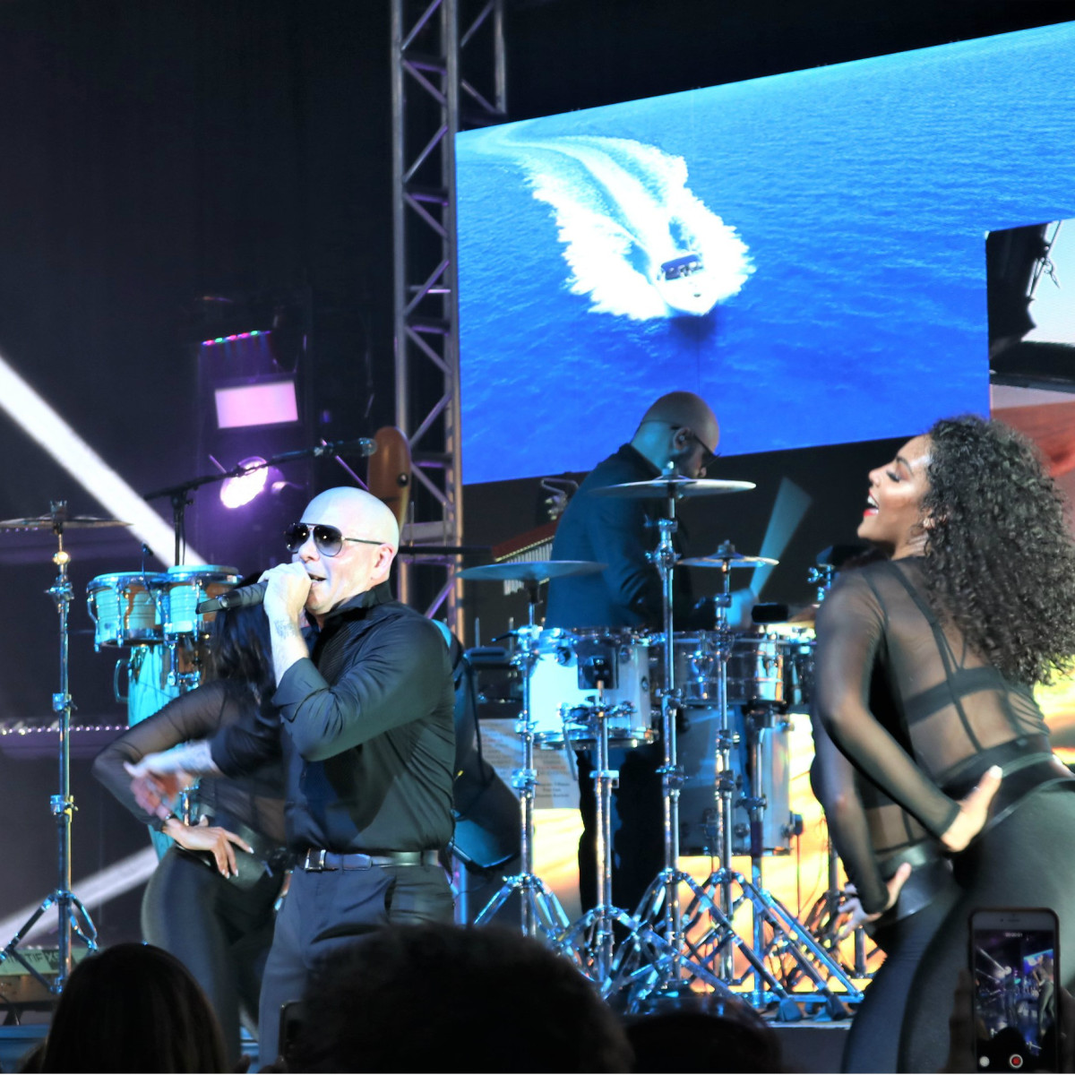 Pitbull and dancers