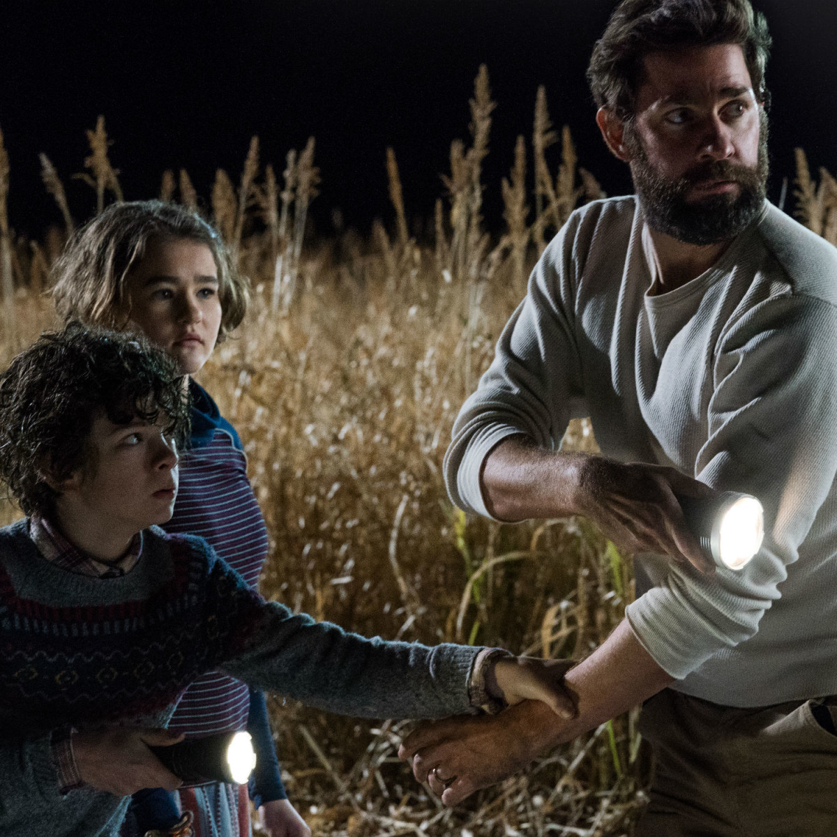 Noah Jupe, Millicent Simmonds, and John Krasinski in A Quiet Place