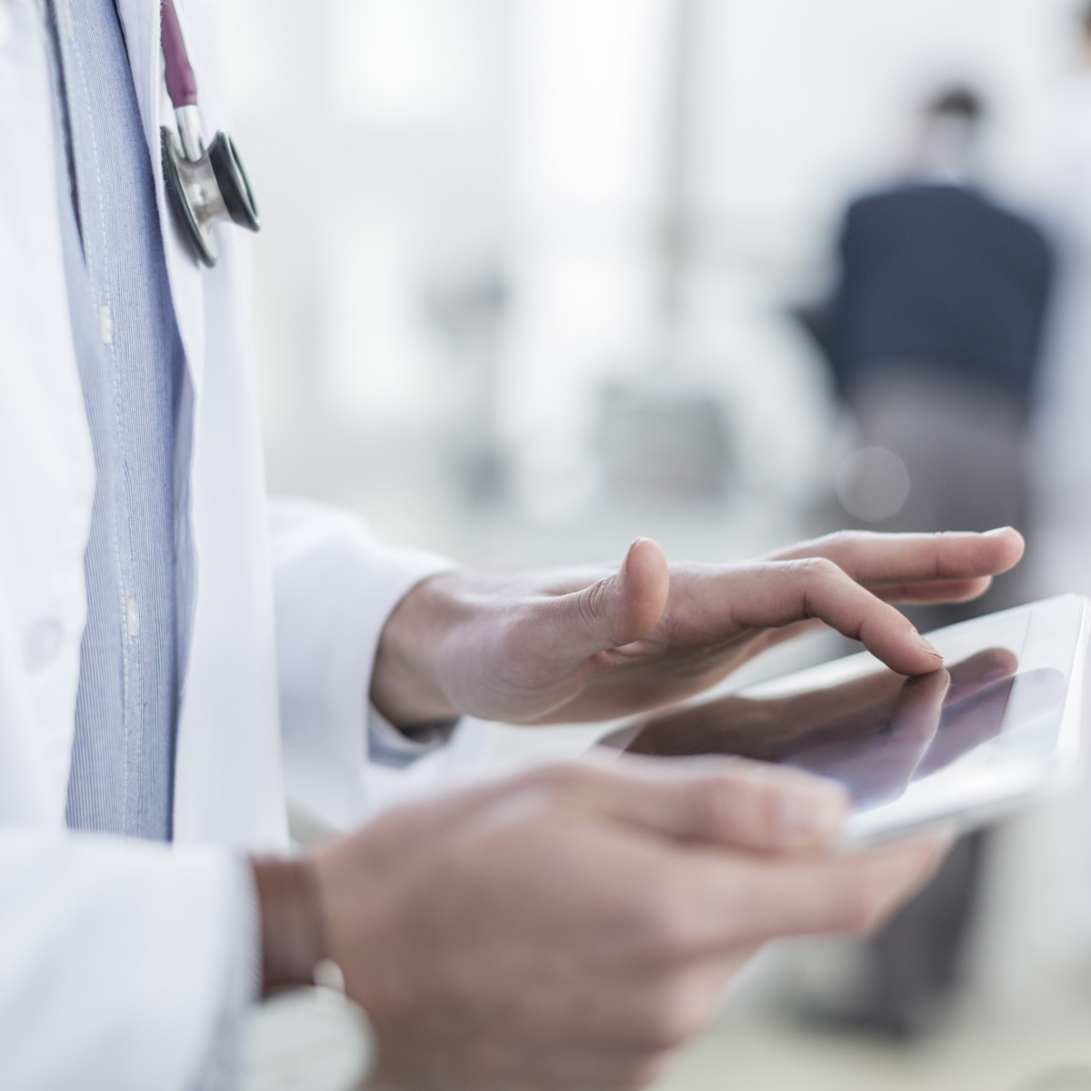 Doctor looking at a tablet