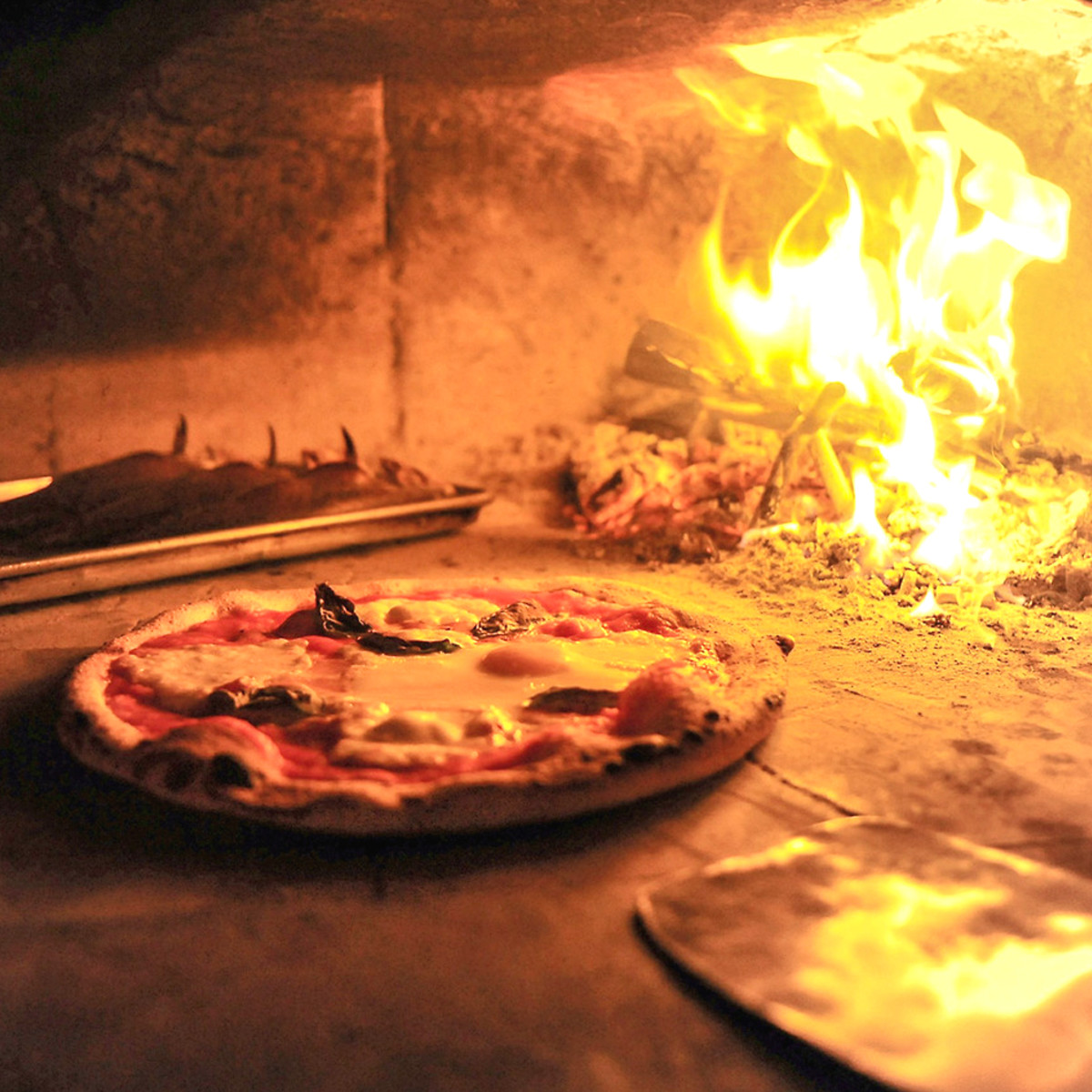 Debora Smail Da Marco Cucina E Vino pizza in pizza oven with fire