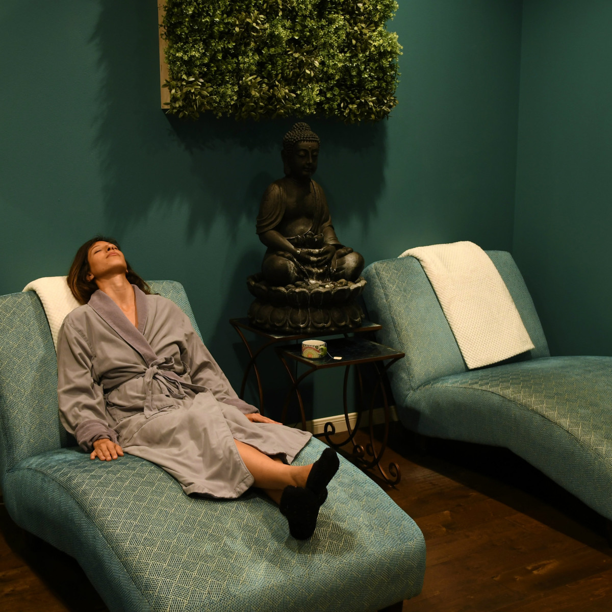 Sanctuary Spa relaxation room woman