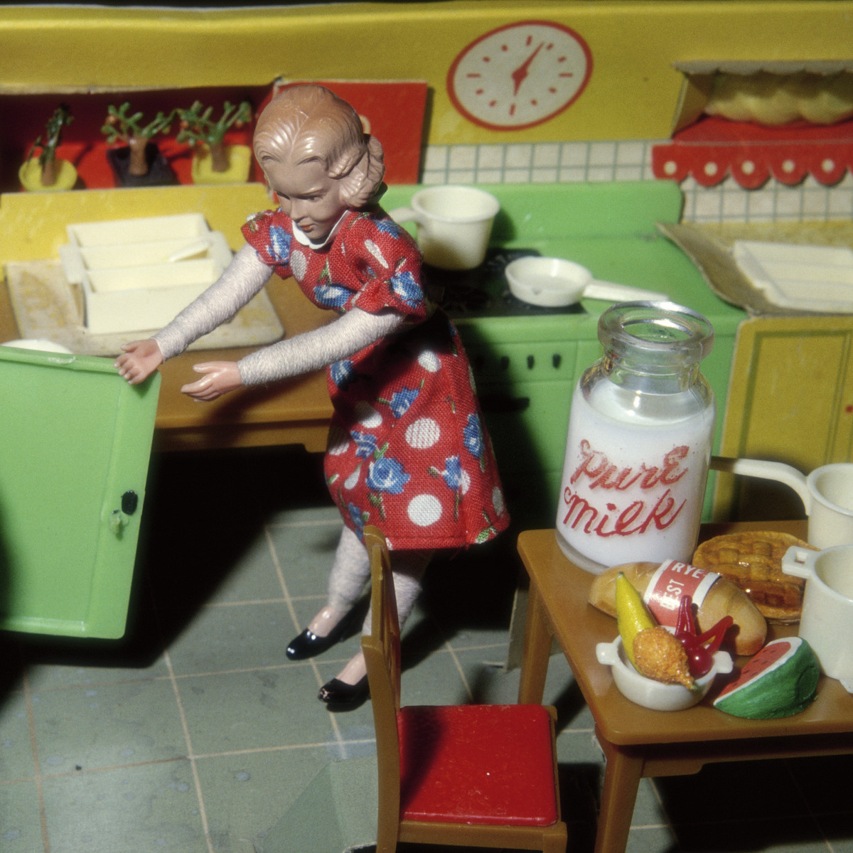 Woman Opening Refrigerator/Milk to the Right