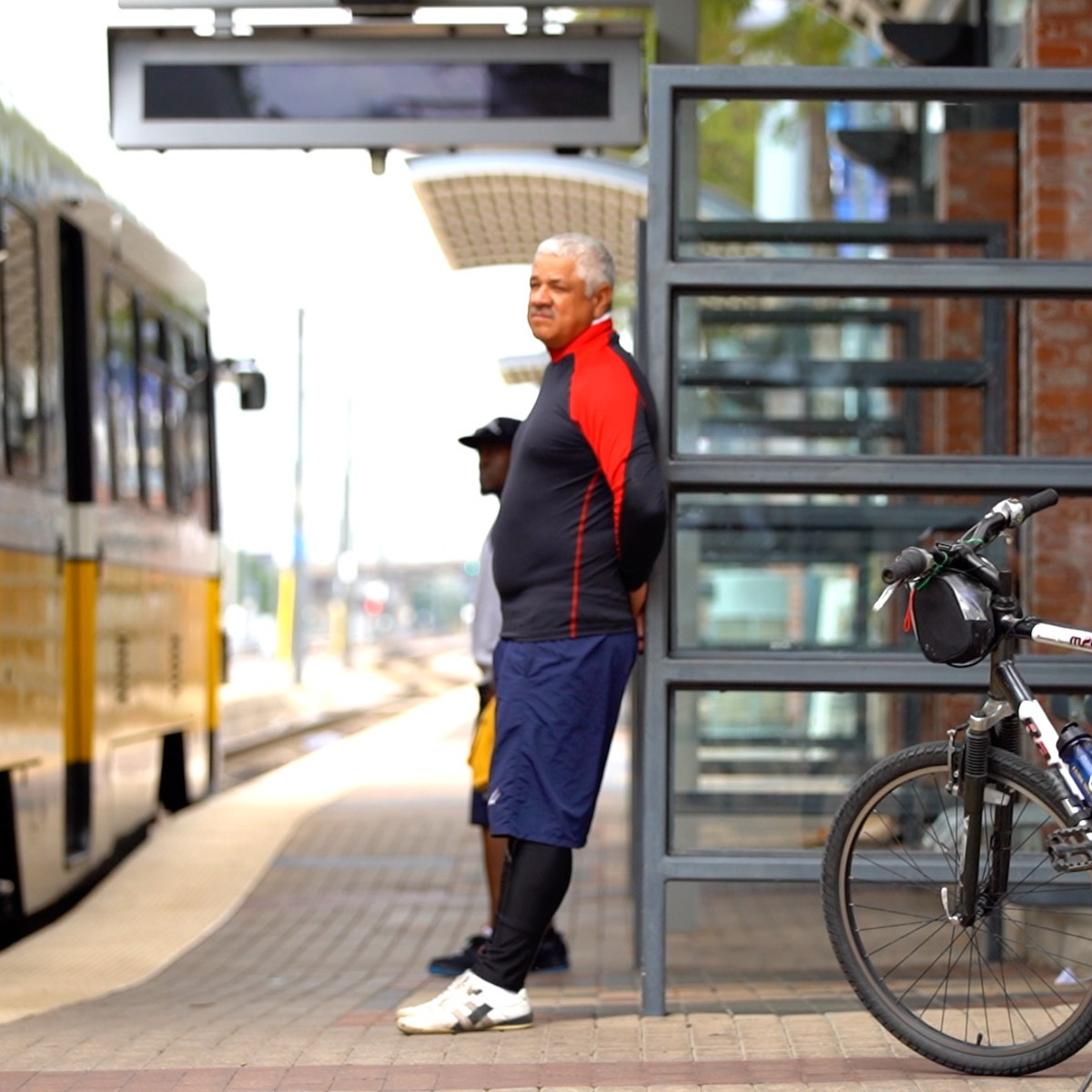 Man waits to board DART with his bike