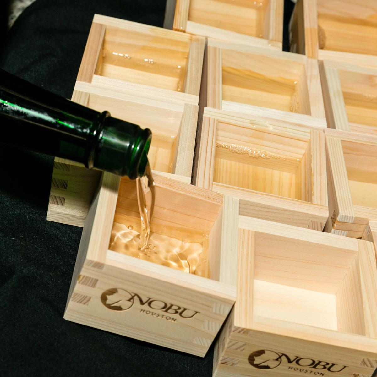 Nobu opening party pouring sake