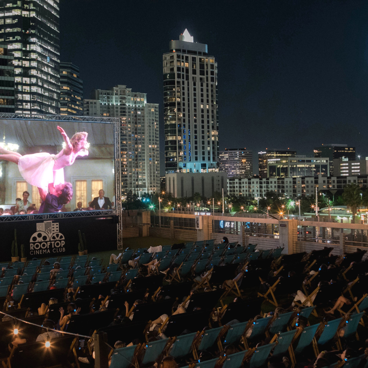 Rooftop Cinema Club Houston night skyline