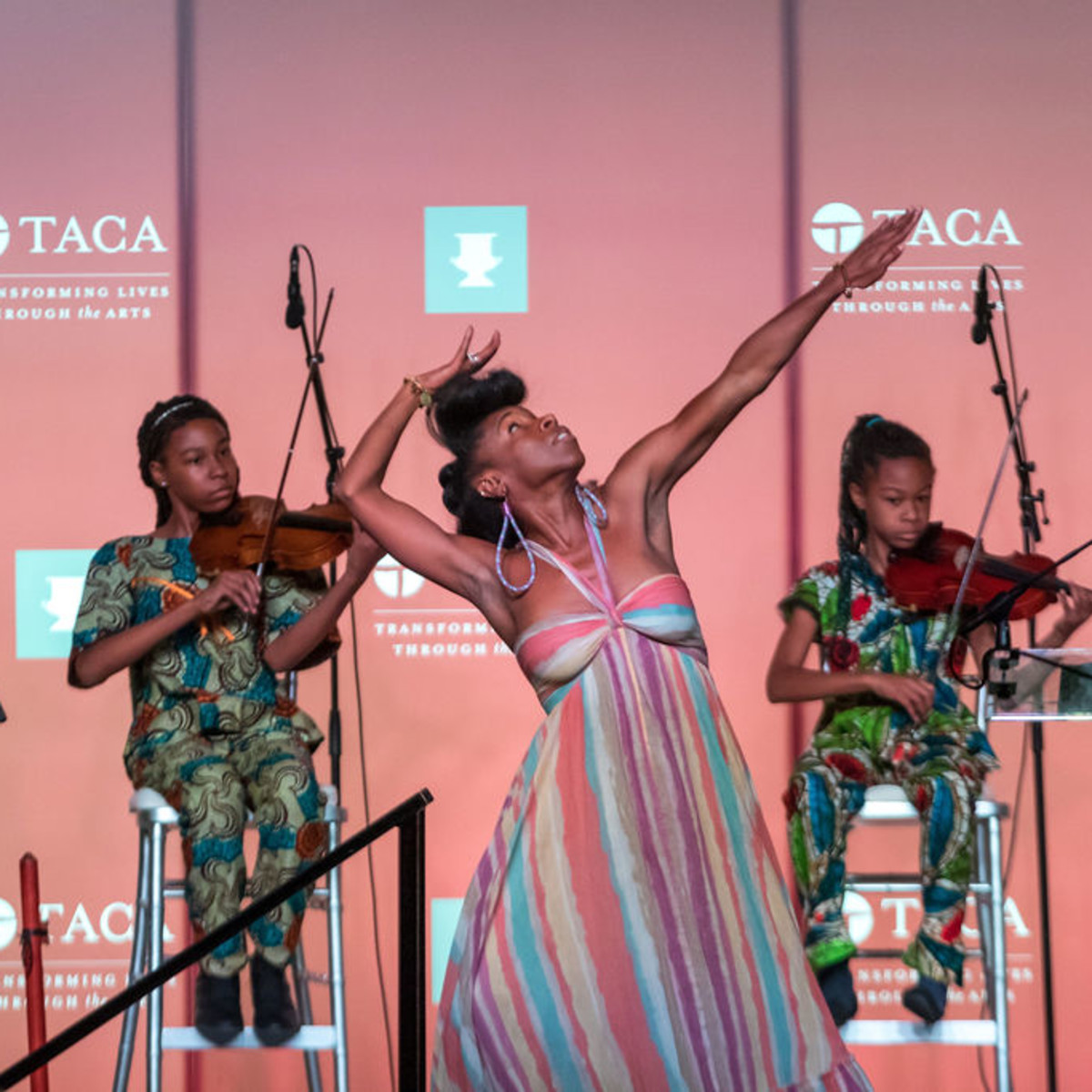 "Performance of ""Dallas: A Glimpse of Our Soul"" by Will Richey and Friends (From left): S-Ankh Rasa, Indigenous American Drone Flute; Aissatouu and Kaira Rasa, Violinists; Iv Amenti, Movement"