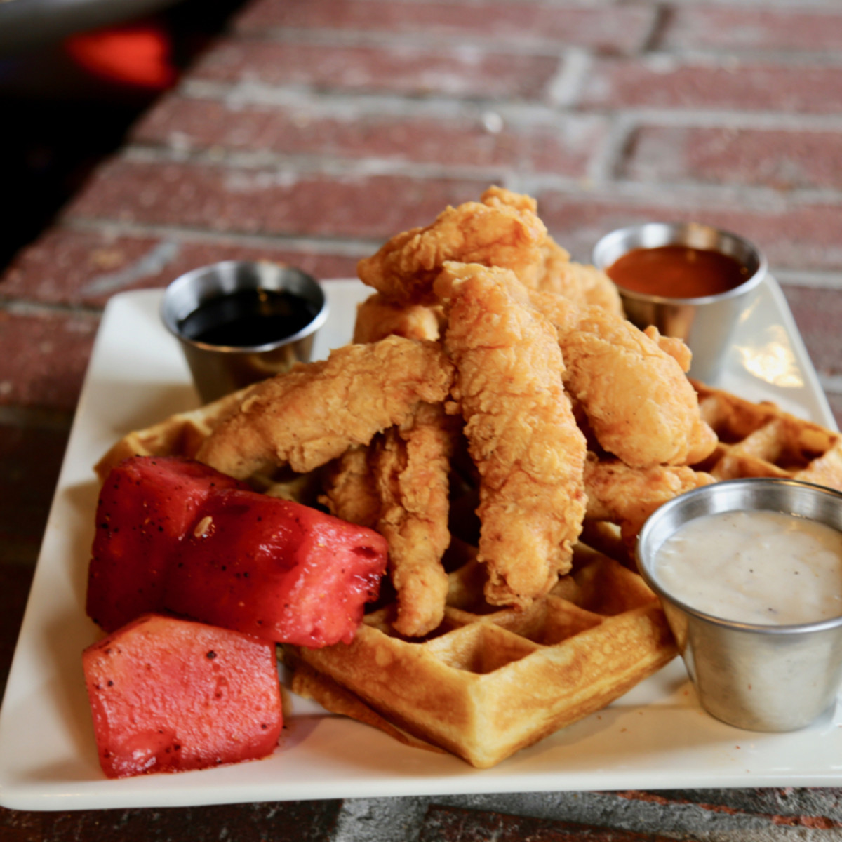 Chicken and waffles with watermelon