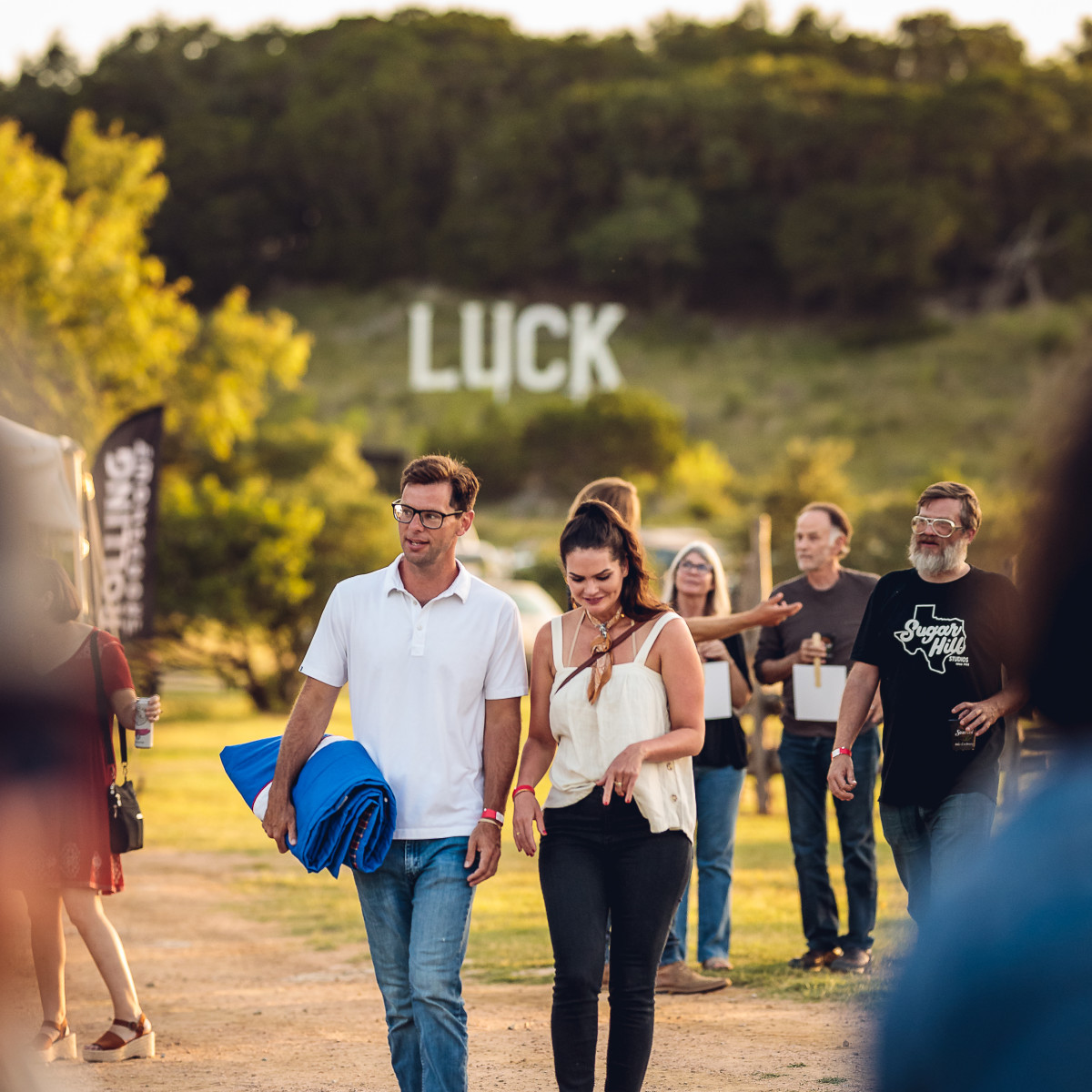 Luck Cinema sign and couple