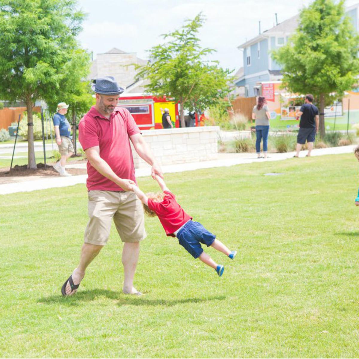 Easton Park dad son kida playing park