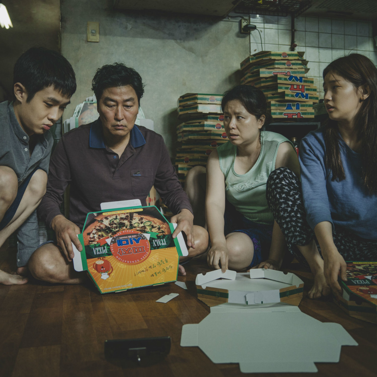Woo-sik Choi, Kang-ho Song, Hye-jin Jang, and So-dam Park in Parasite