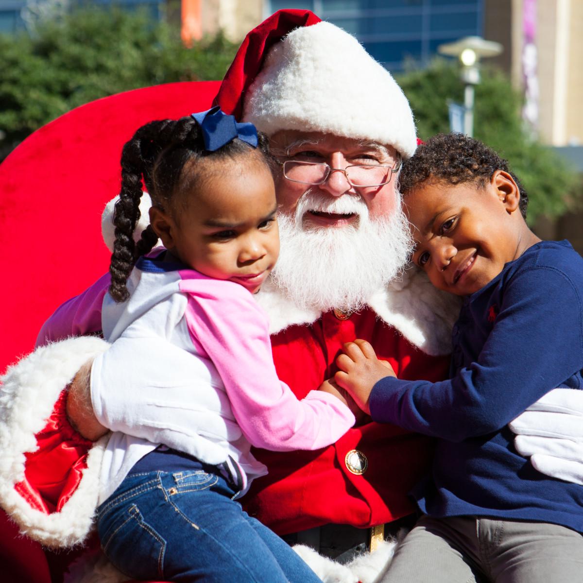 Little kids hugging Santa