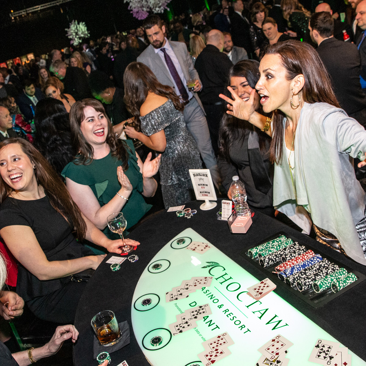Dallas Stars in-game host and National Anthem singer Celena Rae deals blackjack