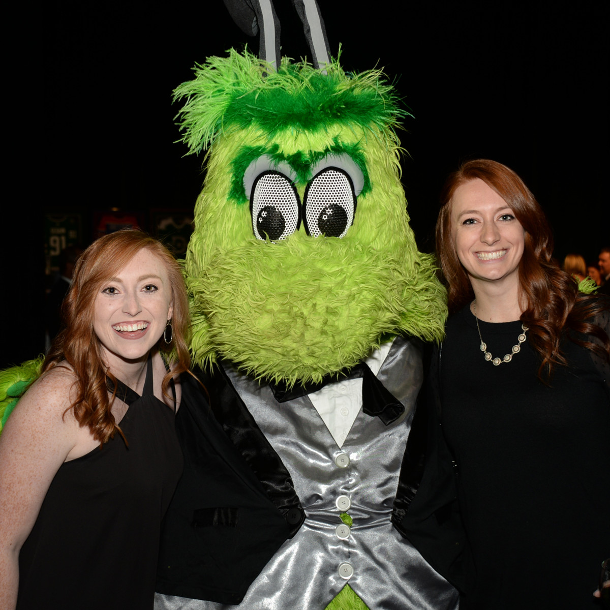 Cassidy Clark and Sydney Bedford with Stars mascot Victor E. Green