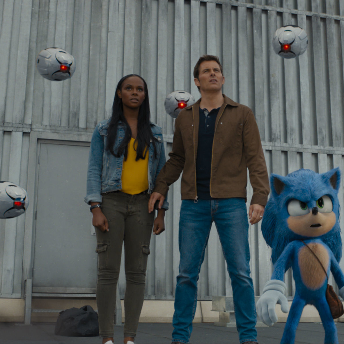 Tika Sumpter, James Marsden, and Sonic in Sonic the Hedgehog