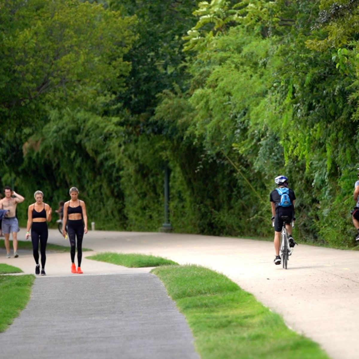 Riding bikes jogging Katy Trail