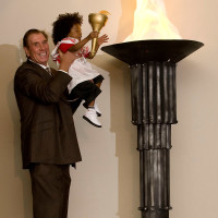 News-Surprises-Rudy Tomjanovich and Jessiah Williams Celebration of Champions