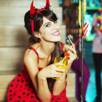 Woman wearing a devil costume at a Halloween party
