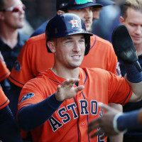Alex Bregman high 5 five Astros orange jersey close up