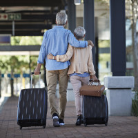 retired couple traveling