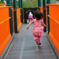 child playing playground running