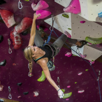 Woman on a climbing wall at Crux Climbing