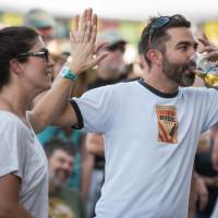 Old Settler's Music festival couple high-five beer