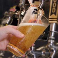 Bartender filling a beer glass